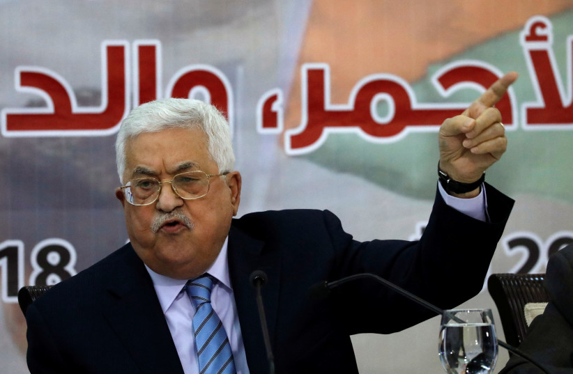 Palestinian President Mahmoud Abbas gestures as he speaks during the meeting of the Central Council of the Palestinian Liberation Organization (PLO) in Ramallah, October 28, 2018 (photo credit: MOHAMAD TOROKMAN/REUTERS)