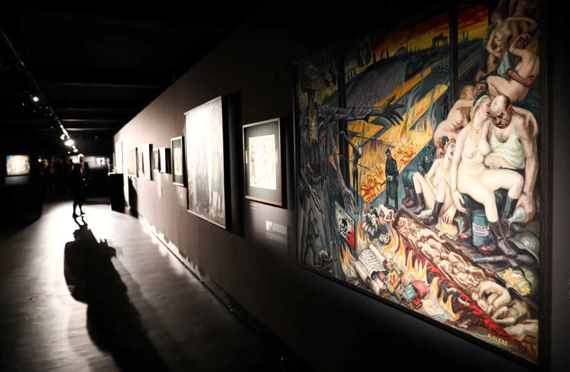 Paintings are pictured during the opening of an exhibition featuring works by David Olere, a prisoner in Auschwitz concentration camp. (photo credit: JAKUB PORZYCKI/AGENCJA GAZETA/REUTERS)