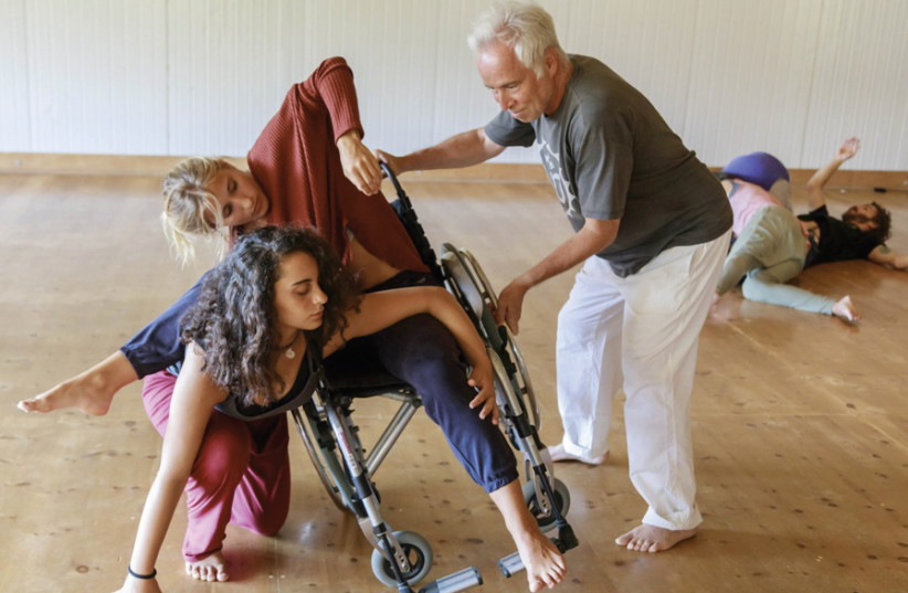 CONTACT IMPROVISATION instructor Mike Fliderbaum practicing the Power of Balance with dance partner Anat. (photo credit: ROUSO MENACHEM)