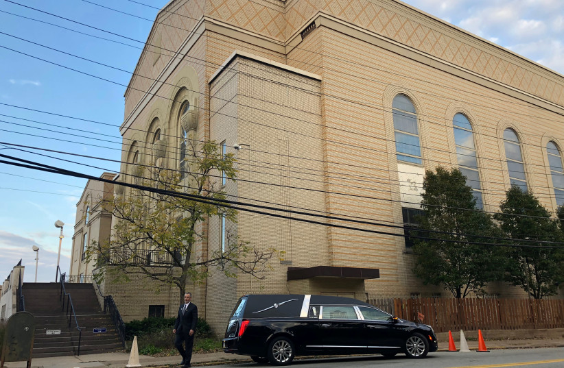 A hearse is parked outside the Beth Shalom Synagogue, where a funeral will be held for Joyce Feinberg. (photo credit: REUTERS/JESSICA RESNICK-AULT)