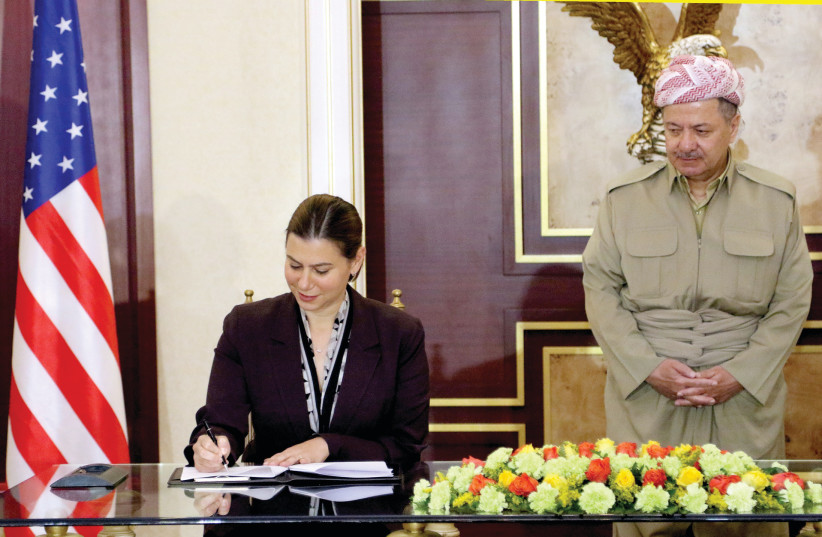 Elissa Slotkin, now a Democratic candidate in Michigan, signs an agreement to support the Kurdistan Region's during the war against the ISlamic State when she was an Assistant Secretary of Defense for International Security Affairs in 2016 (photo credit: REUTERS)