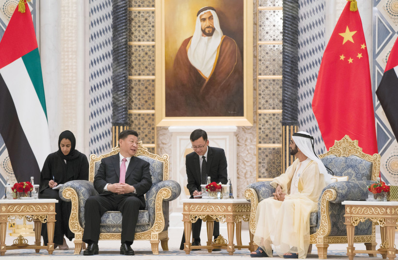PRIME MINISTER and Vice President of the United Arab Emirates and Ruler of Dubai Sheikh Mohammed bin Rashed al-Maktoum meets with Chinese President Xi Jinping at the Presidential Palace in Abu Dhabi, United Arab Emirates in July (photo credit: REUTERS)