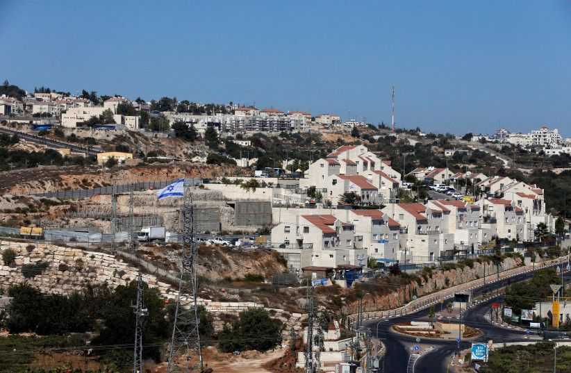 A general view shows the Jewish settlement of Kiryat Arba in Hebron, in the West Bank September 11, 2018. Picture taken September 11, 2018 (photo credit: MUSSA QAWASMA / REUTERS)