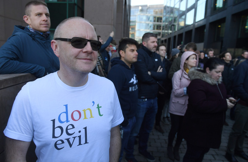 Workers stand outside Google's European headquarters after walking out as part of a global protest over workplace issues, in Dublin, Ireland (photo credit: REUTERS/CLODAGH KILCOYNE)