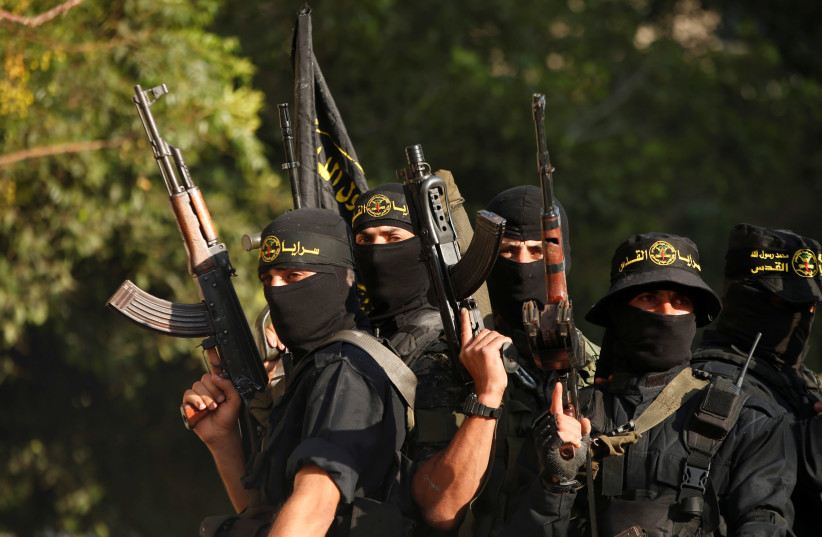Palestinian Islamic Jihad militants participate in a military show in Gaza City (photo credit: MOHAMMED SALEM/ REUTERS)