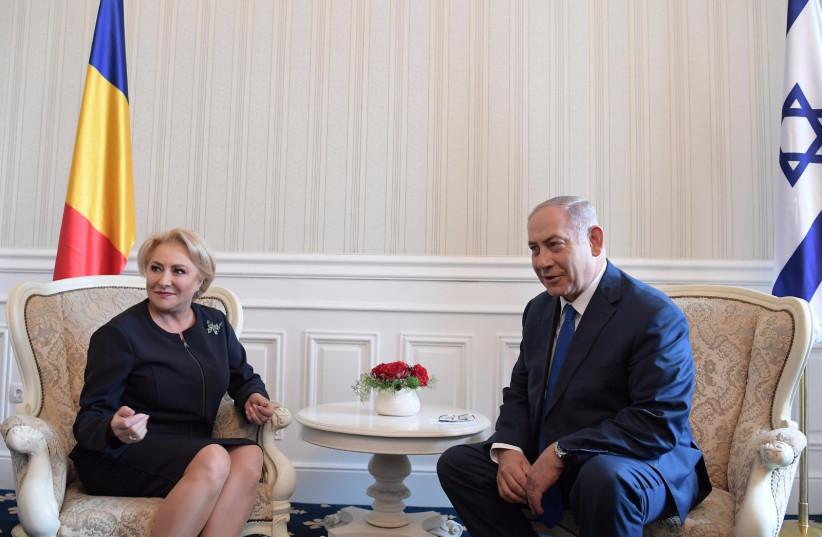 Prime Minister Benjamin Netanyahu meets with Romanian Prime Minister Viorica Dăncilă in Varna, Bulgaria on Friday, November 2, 2018. (photo credit: AMOS BEN GERSHOM, GPO)