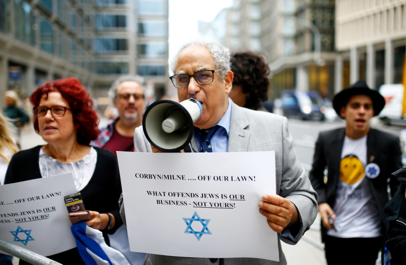 Demonstrators take part in protests outside a meeting of the National Executive of Britain's Labour Party which discussed the party's definition of antisemitism, in London, Britain, September 4, 2018 (photo credit: REUTERS)