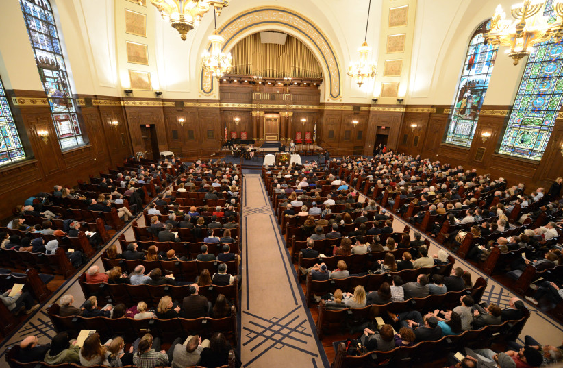"""A large crowd from a wide variety of backgrounds attended a """"Show Up For Shabbat"""" service at the Rodef Shalom synagogue following last Saturday's shooting at the Tree of Life synagogue, in Pittsburgh, Pennsylvania, U.S., November 2, 2018 (photo credit: REUTERS)"""