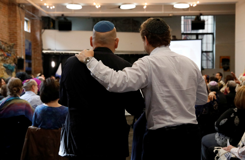 """Worshippers attend a """"Show Up For Shabbat"""" service at JCC Harlem following last Saturday's shooting at the Tree of Life synagogue, in Pittsburgh, in Manhattan, New York, November 3, 2018 (photo credit: ANDREW KELLY / REUTERS)"""
