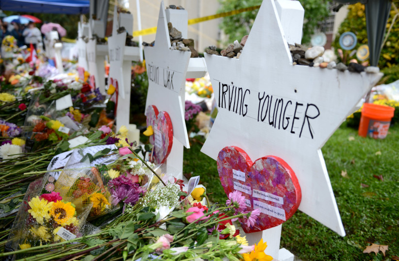 Flowers and other items have been left as memorials outside the Tree of Life synagogue following last Saturday's shooting in Pittsburgh, Pennsylvania, November 3, 2018 (photo credit: ALAN FREED/REUTERS)