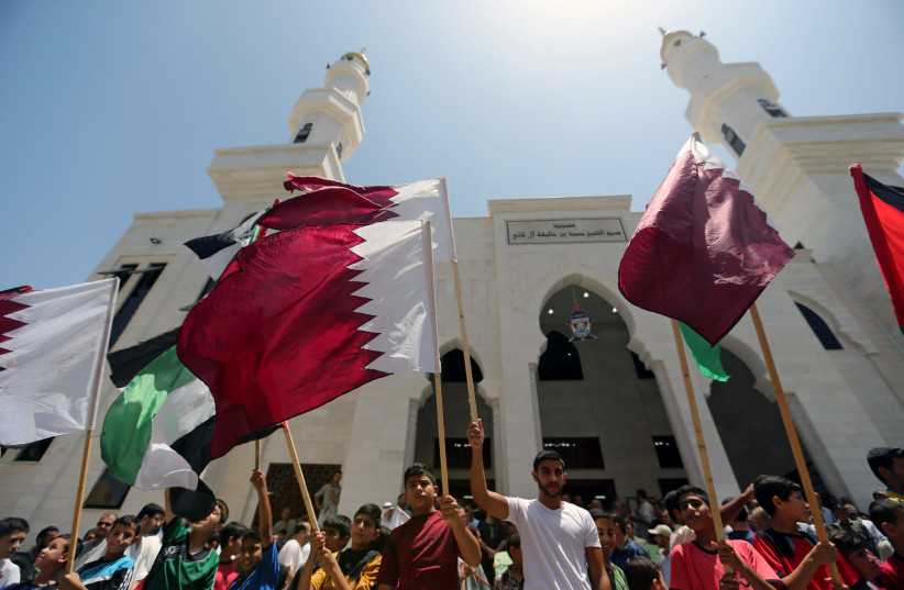 Palestinians take part in a rally in support of Qatar, inside Qatari-funded construction project 'Hamad City', in the southern Gaza Strip, June 9, 2017 (photo credit: REUTERS/IBRAHEEM ABU MUSTAFA)