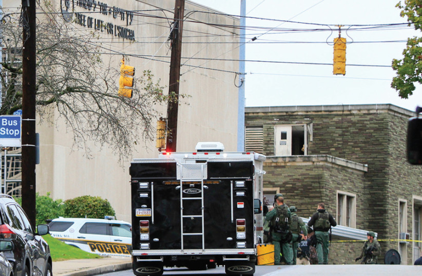 """Police near the """"Tree of Life"""" synagogue in Pittsburgh (photo credit: REUTERS)"""