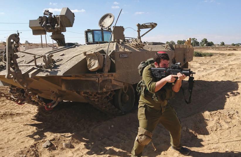 The writer on IDF reserve duty (photo credit: Courtesy)