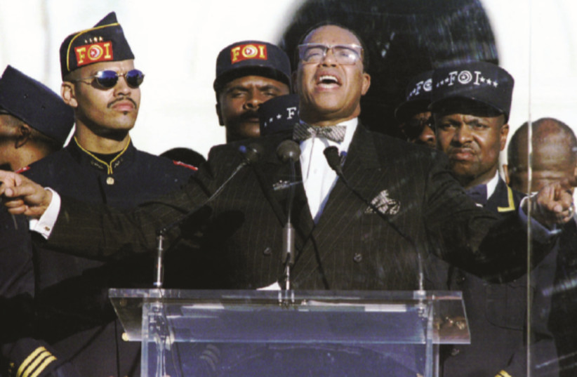 NATION OF ISLAM leader Louis Farrakhan addresses of marchers at the Mall in Washington, DC, during the 'Million Man March' in 1995 (photo credit: MIKE THEILER/REUTERS)