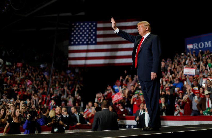 U.S. President Donald Trump waves to supporters at a campaign rally on the eve of the U.S. mid-term elections at the Show Me Center in Cape Girardeau, Missouri, U.S., November 5, 2018. (photo credit: CARLOS BARRIA / REUTERS)