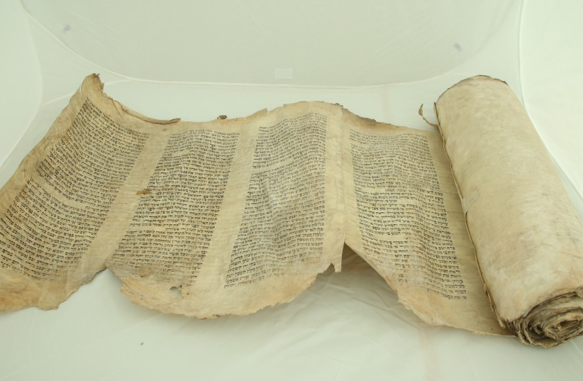 The Torah scroll found in a wooden shack in the Lodz Ghetto.  (photo credit: SHEM OLAM)