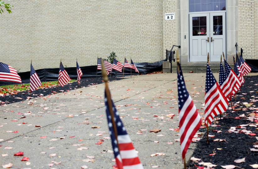 U.S. flags line a path during mid-term elections at a polling station in the Mount Lebanon district in Pittsburgh, Pennsylvania, U.S. November 6, 2018 (photo credit: FEDERICA VALABREGA)
