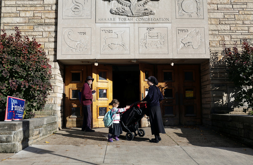 A Jewish Orthodox woman and her daughter wait to vote during mid-term elections at a polling station in Pittsburgh, Pennsylvania, U.S. November 6, 2018 (photo credit: FEDERICA VALABREGA)
