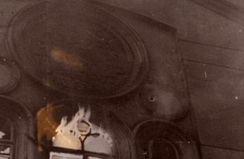 """The """"Kahal Adat Israel"""" Synagogue, known as the Schiffschul, going up in flames during the Kristallnacht pogrom, 9-10 November 1938.  This was the main orthodox synagogue in Vienna, named after the street on which it was situated, Grosse Schiff Street (Grosse Schiffgasse), in Vienna's 2nd District.  (photo credit: YAD VASHEM PHOTO ARCHIVE FA/143/3)"""