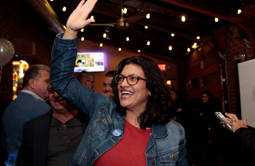 Democratic U.S. congressional candidate Rashida Tlaib reacts after appearing at her midterm election night  (photo credit: REUTERS/REBECCA COOK)