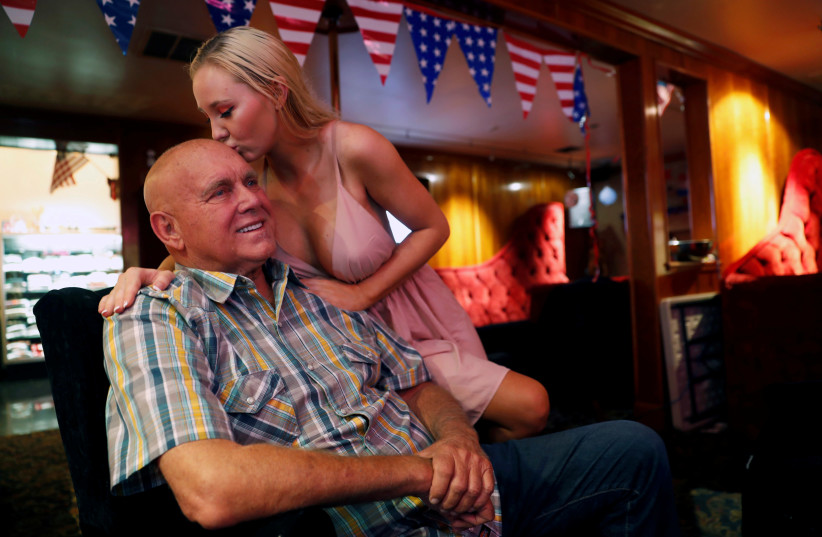Dennis Hof, a legal brothel owner and recent winner of the Republican primary election for Nevada State Assembly District 36, gets a kiss from Misty Matrix, his girlfriend and a legal prostitute (photo credit: REUTERS/STEVE MARCUS)