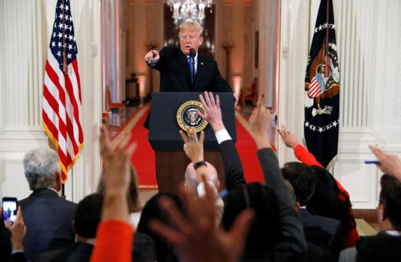 U.S. President Donald Trump points to a questioner while taking questions during a news conference following Tuesday's midterm congressional elections at the White House in Washington, U.S., November 7, 2018 (photo credit: KEVIN LAMARQUE/REUTERS)