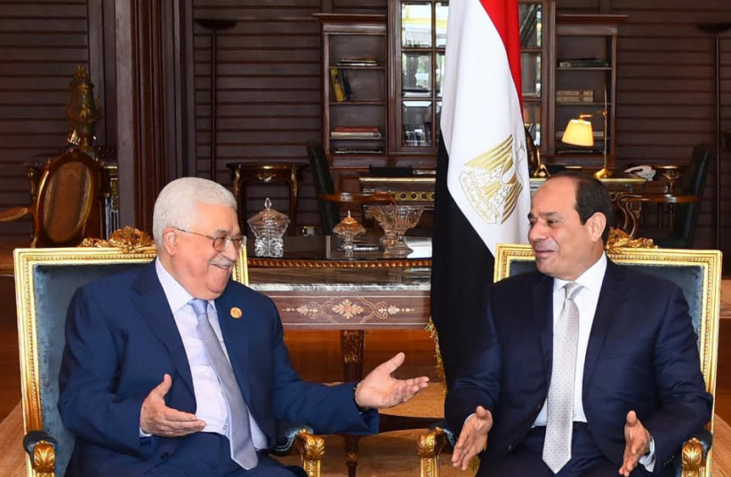 Egyptian President Abdel Fattah al-Sissi (R) meeting with Palestinian President Mahmoud Abbas in the Red Sea resort of Sharm el-Sheikh (photo credit: EGYPTIAN PRESIDENCY / AFP)