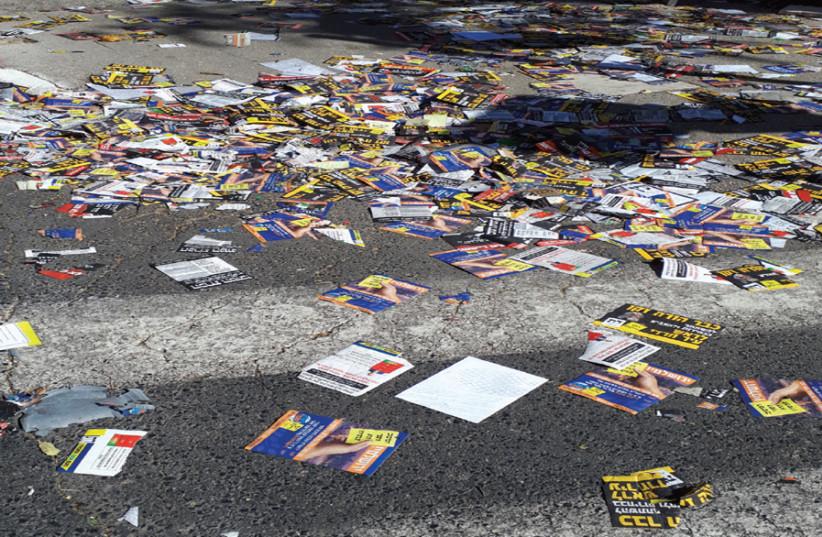 'Flyerim' await street cleaning. (photo credit: NATAN ROTHSTEIN)
