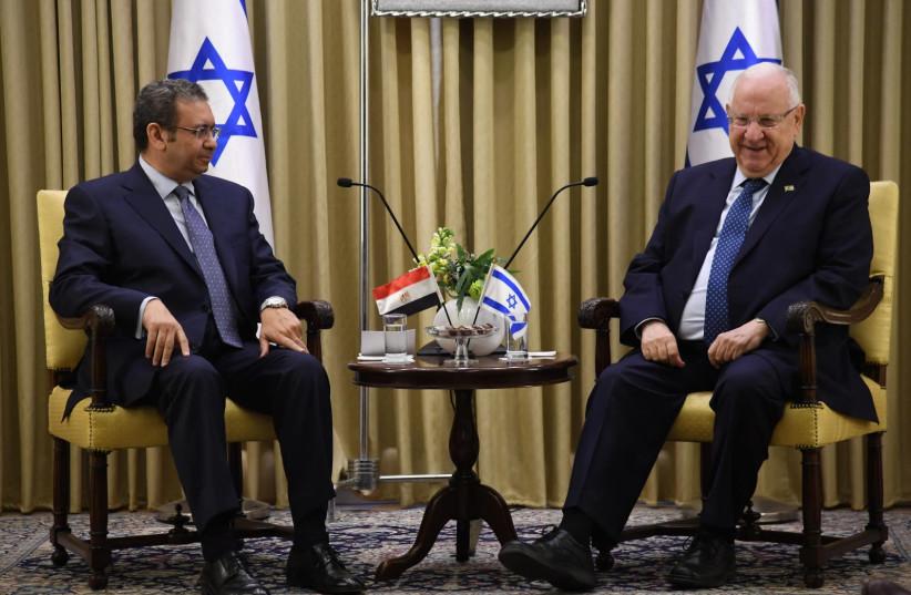 President Rivlin sits with Egyptian ambassador Khaled Azmi (photo credit: HAIM ZACH/GPO)