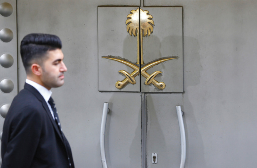 A SECURITY staff member stands at the entrance of Saudi Arabia's consulate in Istanbul on October 31. (photo credit: REUTERS)