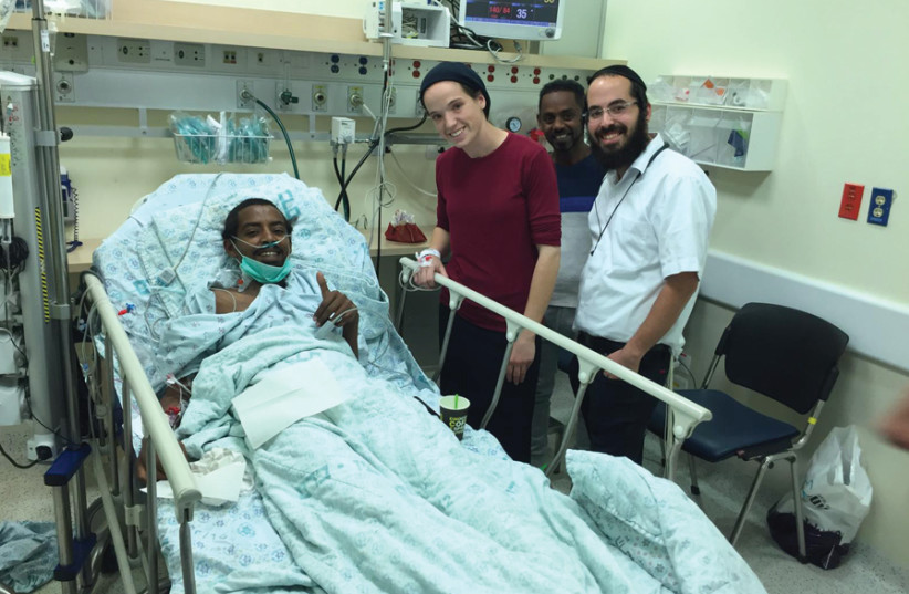 ESTI AND husband Hanan visiting the recipient. (photo credit: HADASSAH UNIVERSITY MEDICAL CENTER)