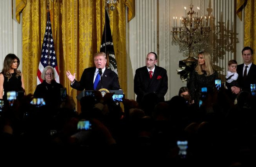 U.S. President Donald Trump hosts a Hanukkah Reception at the White House in Washington, U.S., December 7, 2017 (photo credit: KEVIN LAMARQUE/REUTERS)
