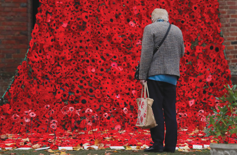 MORE THAN 15,000 poppies, handmade by local craft groups, schools and care homes, are displayed at Hertford Castle in Britain this week to mark the centenary of the end of the First World War (photo credit: ANDREW COULDRIDGE/REUTERS)