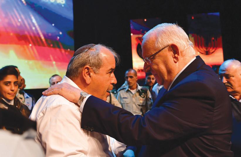 PRESIDENT REUVEN RIVLIN embraces David Malka, the father of the late Hadas Malka (photo credit: KOBI GIDEON/GPO)