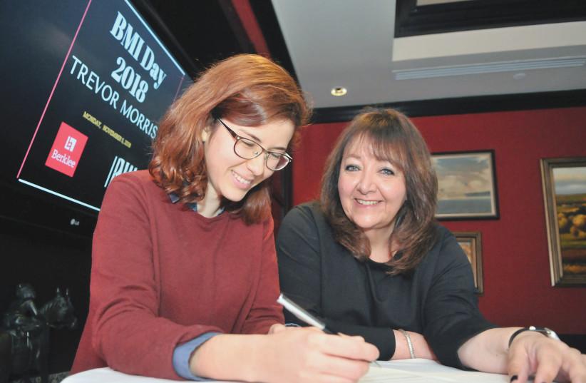 NOA BEAZLEY (left) shares a smile with BMI's Doreen Ringer-Ross. (photo credit: CRAIG BAILEY)