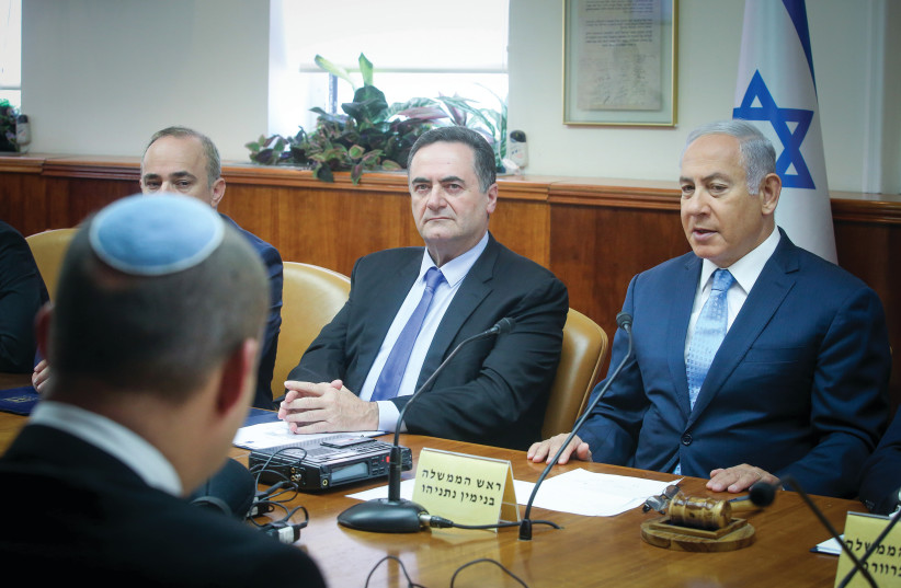 PRIME MINISTER Benjamin Netanyahu convenes his cabinet in Jerusalem. The election date is up to him.  (photo credit: MARC ISRAEL SELLEM)