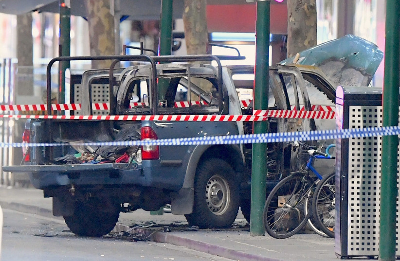 A burnt out vehicle is surrounded by police tape on Bourke Street in central Melbourne, 2018. (photo credit: AAP/JAMES ROSS/VIA REUTERS)