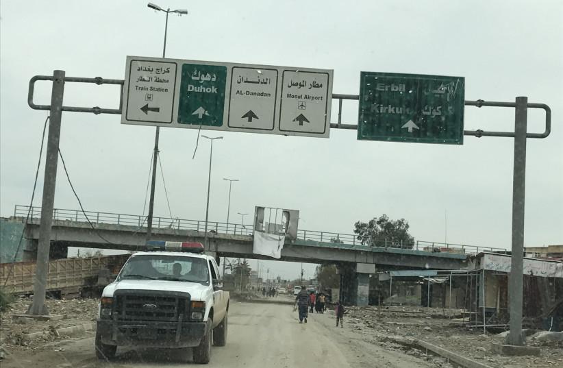 A street near Mosul's Al-Jadeeda neighborhood last year during the liberation of the city from ISIS control. (photo credit: SETH J. FRANTZMAN)