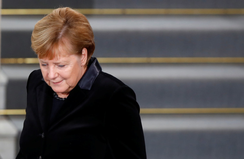 German Chancellor Angela Merkel is pictured after speaking during a ceremony to mark the 80th anniversary of Kristallnacht, also known as Night of Broken Glass, at Rykestrasse Synagogue, in Berlin, Germany, November 9, 2018 (photo credit: AXEL SCHMIDT/REUTERS)