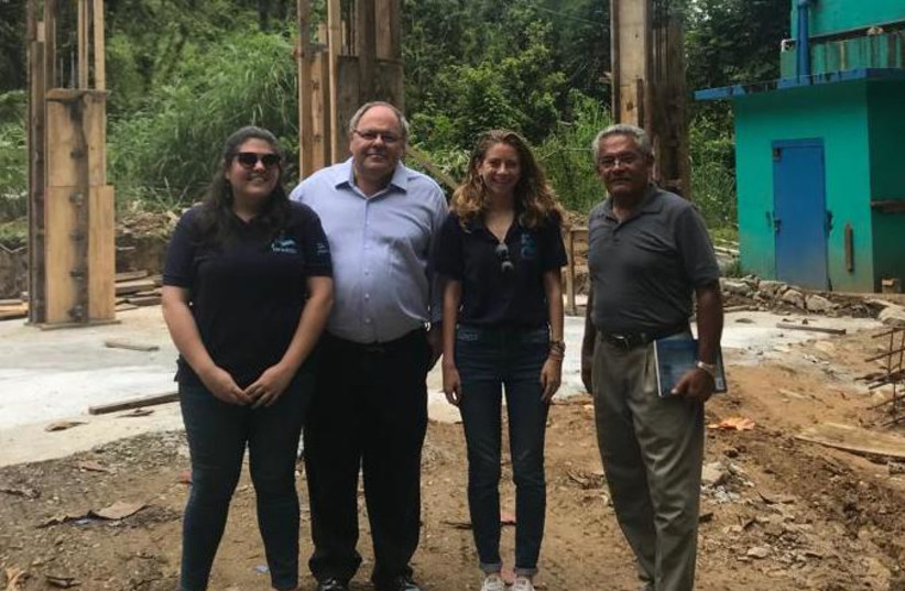 Consul to NY Dani Dayan visits an IsraAID site earlier this year (photo credit: ISRAEL CONSULATE IN NEW YORK)