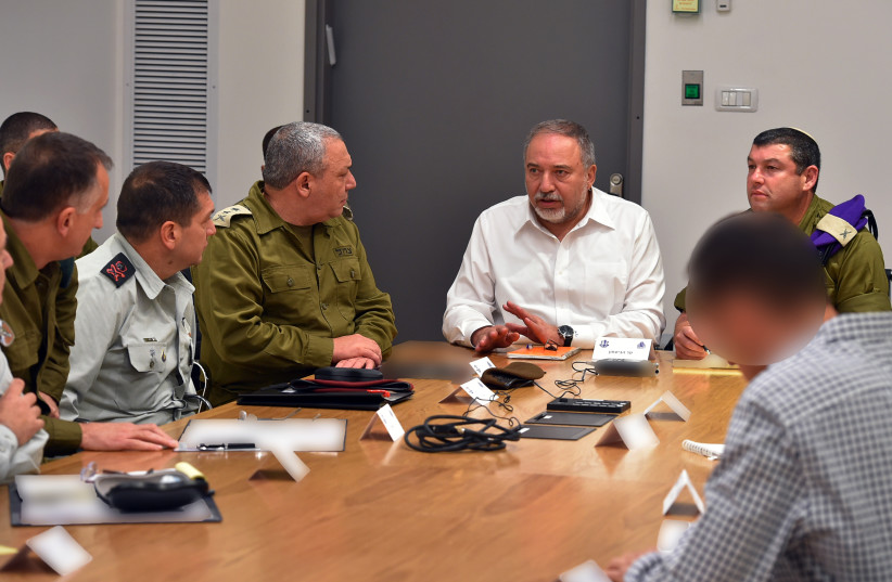 Defense Minister Avigdor Liberman and other top IDF personnel in a security meeting in Tel Aviv  on Sunday, November 11. (photo credit: ARIEL HERMONI/DEFENSE MINISTRY)