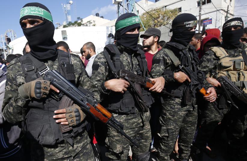Palestinian militants of the Islamist movement Hamas' military wing Al-Qassam Brigades (photo credit: SAID KHATIB / AFP)