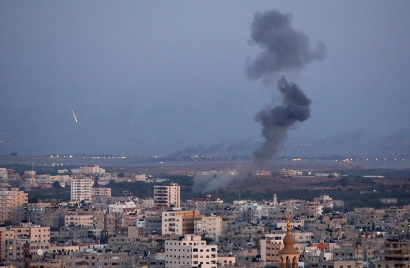 Smoke rises during an Israeli air strike in Gaza, November 12, 2018 (photo credit: AHMED ZAKOT / REUTERS)