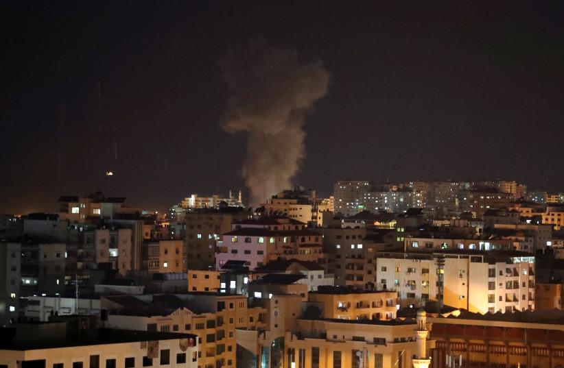 Smoke rises following an Israeli air strike in Gaza November 12, 2018 (photo credit: REUTERS/SUHAIB SALEM)