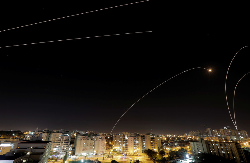 A general view of the Israeli city of Ashkelon, as an Iron Dome anti-missile fires near the Israeli side of the Israel-Gaza border, November 12, 2018. (photo credit: REUTERS/AMIR COHEN)