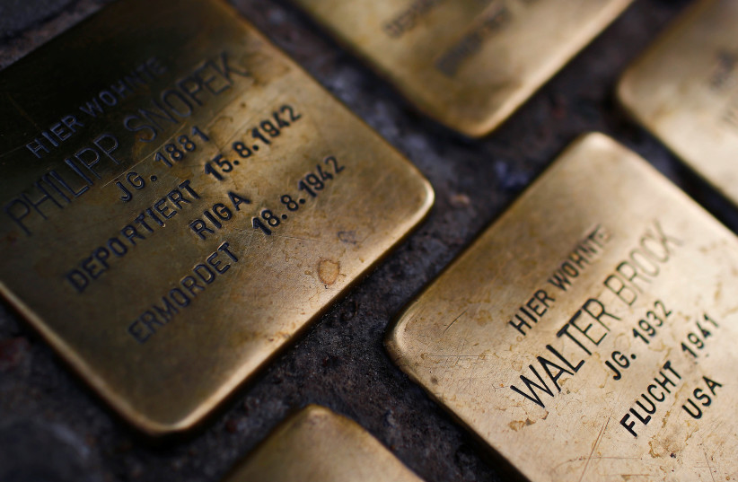 """Parts of the Holocaust memorial project """"Stolpersteine"""" (stumbling blocks) are pictured in Berlin, Germany, August 18, 2017.  (photo credit: REUTERS/HANNIBAL HANSCHKE)"""