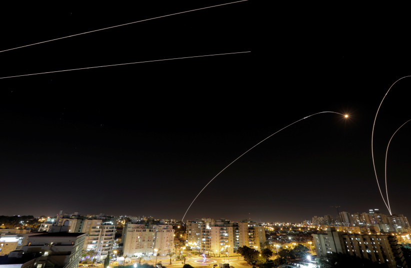 A general view of the Israeli city of Ashkelon, as an Iron Dome anti-missile fires near the Israeli side of the Israel-Gaza border, November 12, 2018 (photo credit: AMIR COHEN - REUTERS)