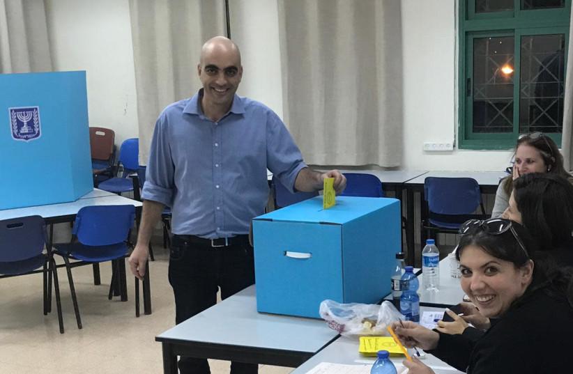 Candidate Ofer Cohen voting in Kfar Vradim. (photo credit: Courtesy)