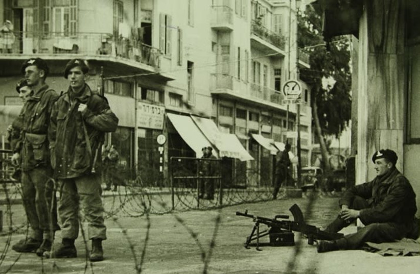 British soldiers enforcing a curfew in Tel Aviv during the 1940s (Haim Fein at the Emanuel Harussi Photograph Collection) (photo credit: NATIONAL LIBRARY OF ISRAEL)