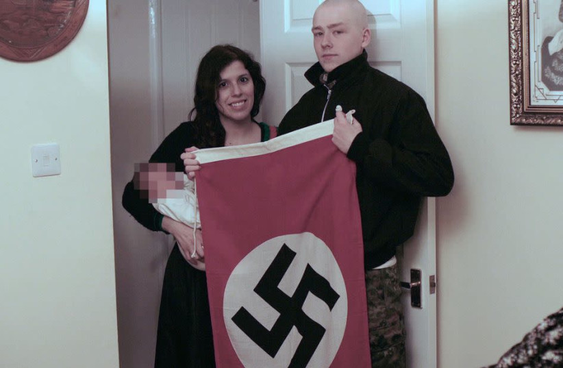ADAM THOMAS and his girlfriend, Claudia Patatas, pose for a photo with their baby, who they named after Adolf Hitler (photo credit: WEST MIDLANDS POLICE)